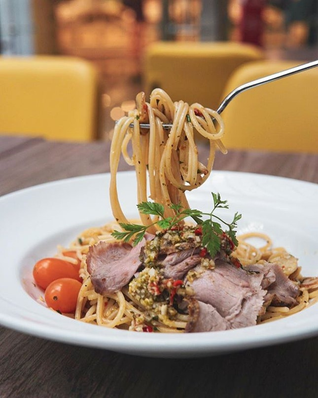 A hot favourite & the Butcher's signature dish, the Porky Aglio Olio ($15.80) features spaghetti tossed in thai chilli padi sauce and thinly sliced thai-style pork collar.