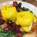 Eggs that run over bacon-overloaded English muffins ($18).