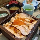 Salmon teriyaki over Japanese rice served in a wooden box!