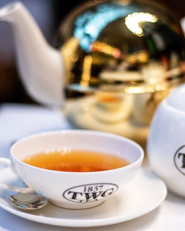 Afternoon tea with a selection of over a hundred variety of teas in a golden teapot.