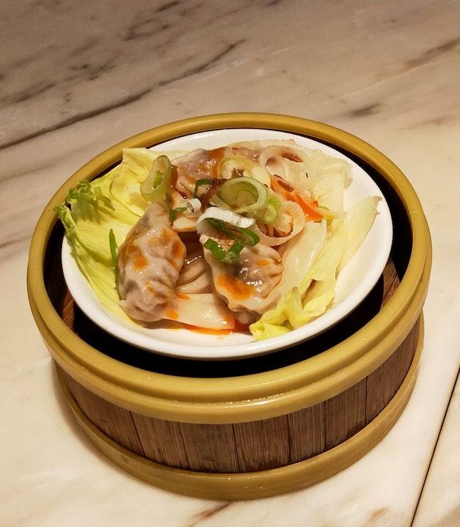 Spicy Marinated Pork Steamed Dumplings