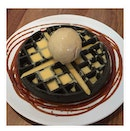 Pistachio ice cream with salted yolk sauce on charcoal waffle