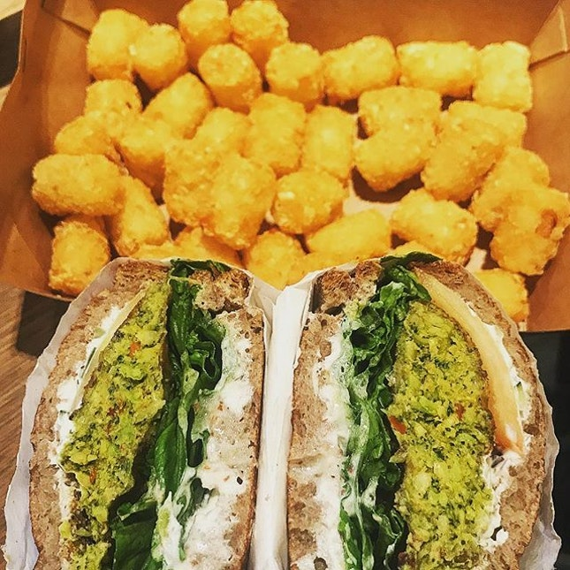 Sometimes all the carbs are just necessary....broccoli falafel, spinach, dried cranberries and aioli in toasted rye bread and an enormous box of tater tots.