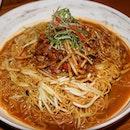 Crackling Pork Belly Ginger Scallion XO Noodles, $22