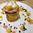 Mango Tango [$10.90] : stacked mini pancakes with mango and whipped cream.