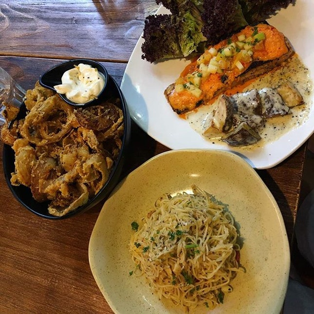 Zesty crab angel hair pasta, pan seared salmon steak and the signature onion side dish at the glass onion!