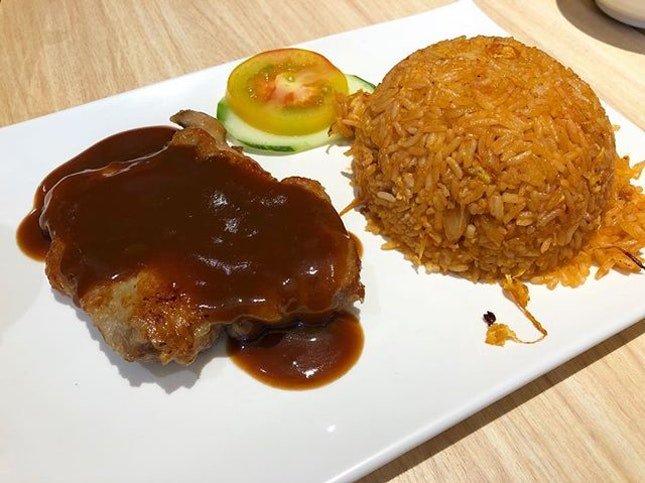 Macau fried rice (which is tomato fried rice) with chicken cutlet.