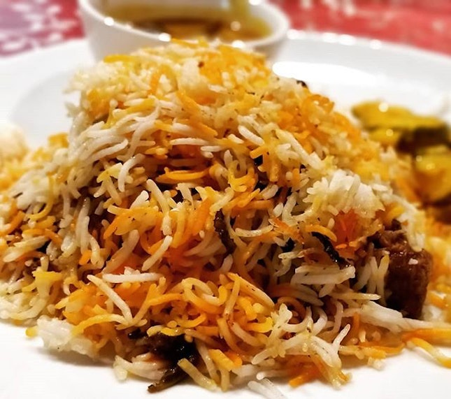 #cxyi - 7th March 2019 - this unassuming plate of briyani hides a whole chicken thigh underneath.