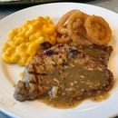 Pork ribeye, Mac and cheese, and onion rings...