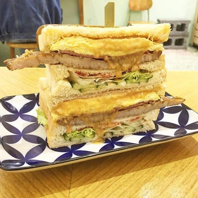 双肉花生烘蛋 (NT85) - Signature sandwich that encompasses an Omelette, grilled bacon, a small slab of Pork chop, over a layer of peanut butter.