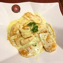 Ravioli Di Salmone ($11.50) - Salmon and mushrooms encased in the pasta shell.