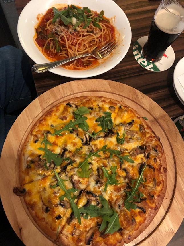 Mushroom Truffle Flatbread Pizza ($24) And Caprese Pasta ($22)