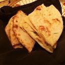 Garlic Naan and Kulcha (stuffed naan with potatoes and onions)