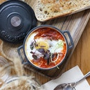 """BAKED EGGS 🍳 at @pazzioncafe  Went out to brunch and decided to go out of my comfort zone of """"eggs benedict"""" or """"french toast"""" and tried baked eggs that are similar to Shakshuka, ie are eggs and tomato sauce with other things baked in a skillet, served with a toast."""