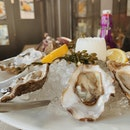 $1 oysters during happy hour