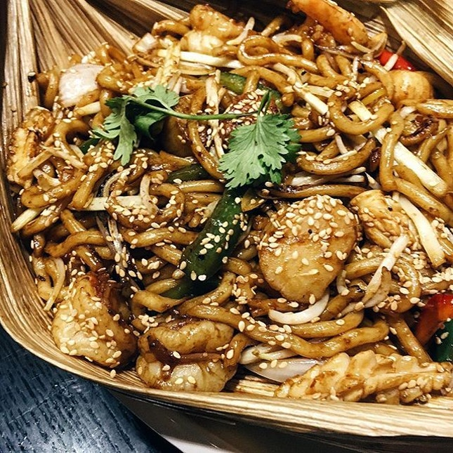 Yummy wok fried seafood udon in oba leaf from @lanting_sg.