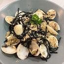 Clams and Crabmeat Aglio Olio in White Wine Sauce ($15)