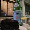 "Enjoying a lovely cake ""Blackout"" rich chocolate cake at Lucky Peaches #luckypeaches #cake #chocolatecake #instafood #foodporn #instacake #brianleowfoodhunt #burpple #desserts #pellegrino #spellegrino #sparklingwater #delicious"