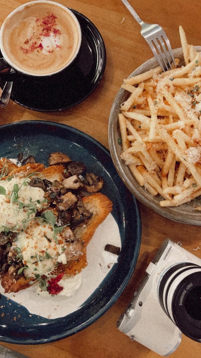 Truffle Fries ($11) Mushroom Croissant Benedict ($18) Rose Latte ($6)