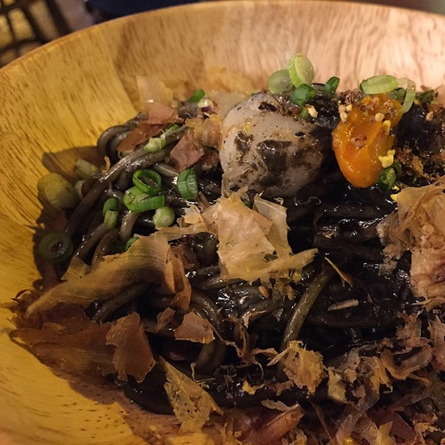 Brand new: Squid ink pasta in sea urchin cream, topped with liberal bonito flakes and chopped scallions.
