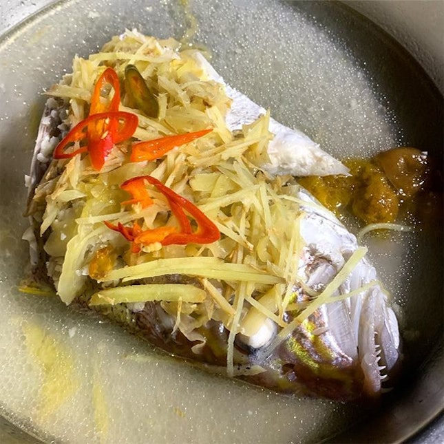 Steamed Fish Head _ Fresh Snapper Fish head, topped with slices of ginger, salted vegetables, chilli, steamed to perfection.