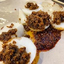 Chwee kueh aka steamed rice cake _ Topped with preserved radish bits and sambal chilli by the side.