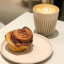 Cinnamon bun with Flat White.