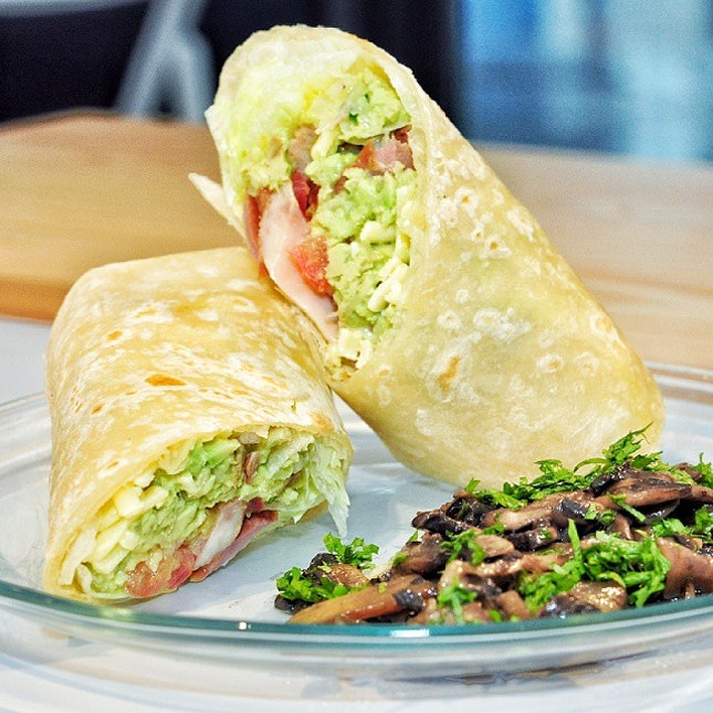 Burrito with mango guacamole and duck meat stuffing (SGD 10)