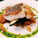 Pan-seared seabass served on a bed of ratatouille and basil emulsion.