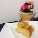 Pineapple pound cake with a shot of orange pear fruit enzyme.