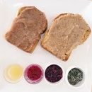 Lover's Set from Gobi Desserts – toast served with orange-pear, red and white dragonfruit fruit enzyme jams, and pineapple and red dragonfruit fruit enzyme shots.