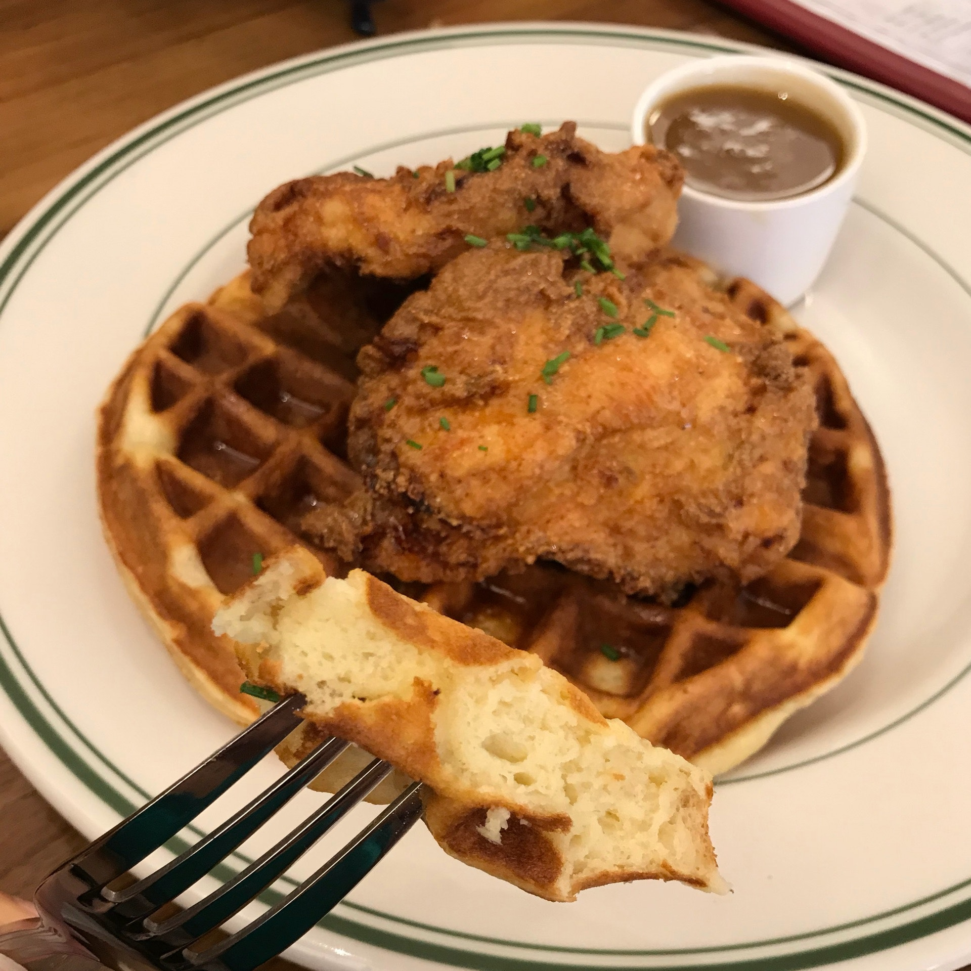 Chicken & Waffles [$21] With honey-Tabasco sauce drizzled over a soft vanilla buttermilk waffle, and our signature warm maple butter