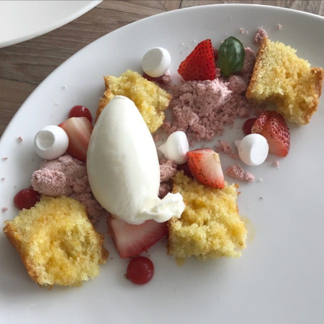 Tunisian Orange Cake served with strawberry, yoghurt ice cream.