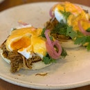 Free-range  Eggs Benedict  Chipotle hollandaise, pickled onion, pulled pork [$18]