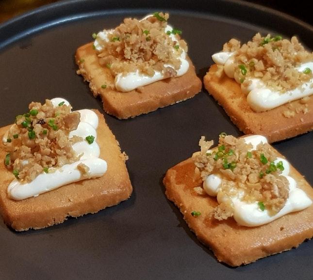BISCUIT - chicken fat cookie, ginger spiced cream, crispy chicken skin [$12]