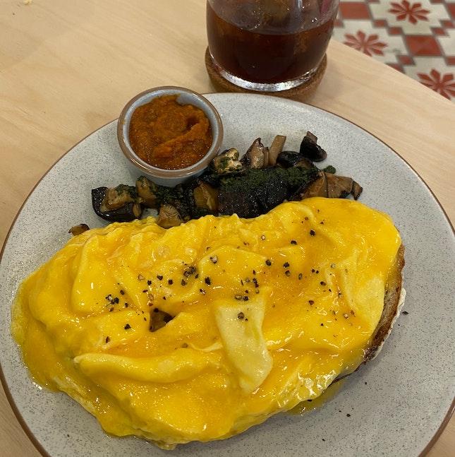Scrambled free range egg tartine - charred mushroom - basil walnut pesto [$14]