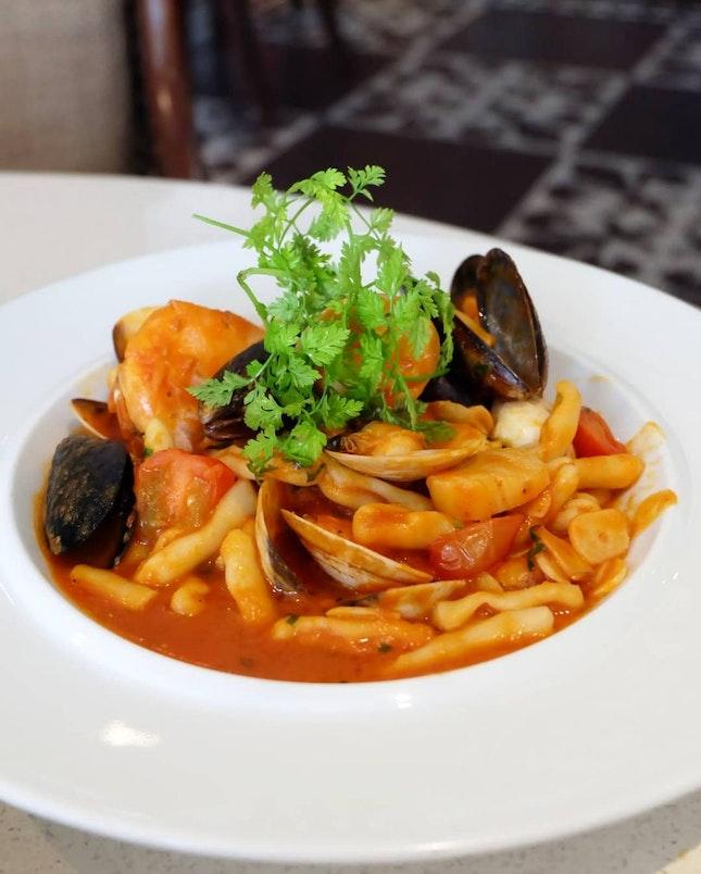Cavatelli pasta sautéed with mixed seafood in light tomato sauce