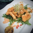 Crispy squid with spicy salsa rosa and BBQ lime.