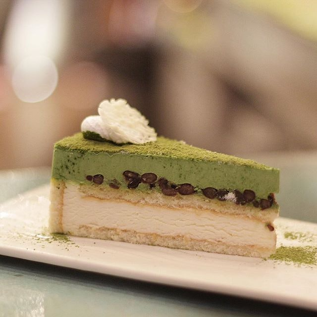 Matcha Mousse Cake  Nothing beats a pillowy soft matcha mouse cake with a layer of sweet red beans sandwiched in between.