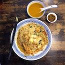 Da Shi Jia Big Prawn Mee 大食家大大大虾面 The rich savory-sweet red-orange broth was served with wok-fried bee hoon and juicy prawns, Kang kong, slices of pork and most importantly pork lard!