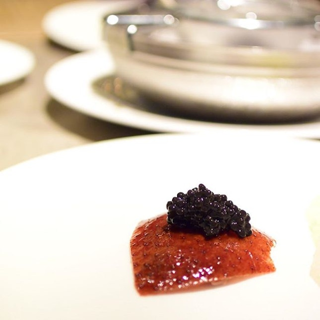 Crispy Peking duck skin and a spoonful of sturgeon caviar, absolutely mind blowing.