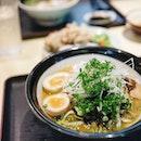 Rainy days and dreams of cradling bowls of steaming hot ramen beholding perfectly tucked in pork belly roulade  Karamiso Tonkotsu Ramen from #yoshimaruramenbar on my mind this Monday morning  #8dayseat #hungrygowhere #singaporeinsiders #sipandgulp #vscofood #burpple #sgramen #hollandvillageEats #i8mondays #instafood_sg #eatoutsg