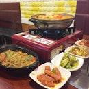 Hearty dinner at Guiga: Dakdoritang and Japchae, accompanied by 6 banchans.