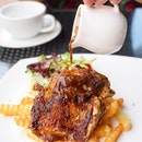 Chicken chop [$10.80] served with fries and greens.