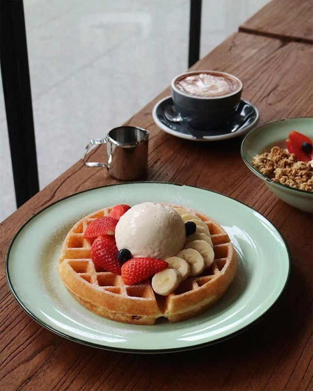 Freshly baked waffles with a cup of flat white and excellent companion...