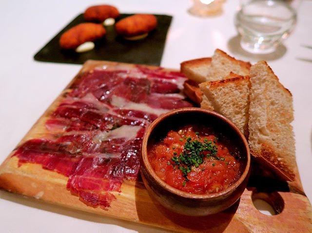 Jamon De Pata Negra 1/2 portion - $25 The bread was soooo good (I'm a sucker for bread) and I never expect myself to like tapas like this.