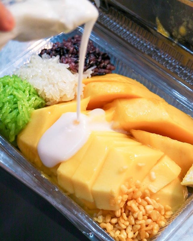 3 kinds of sticky rice, some rice krispies, a dollop of that coconut cream and an entire whole mango that's super sweet at just 130 THB.