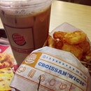 When loneliness accompanies, fast food is the way to go. #breakfast #bk #lonelymeal #croissantwich #hashbrowns