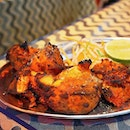 King of Tandoor, Tandoori Chicken ($14/Half) Tender fresh chicken thoroughly marinated in yogurt, rare spices, lime juice & saffron; and passionately barbecued in clay oven over burning charcoal.