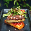 Classic Foie Gras ($16.90) Pan fried foie gras served atop toasted brioche with a fruit jam spread alongside petit salad.